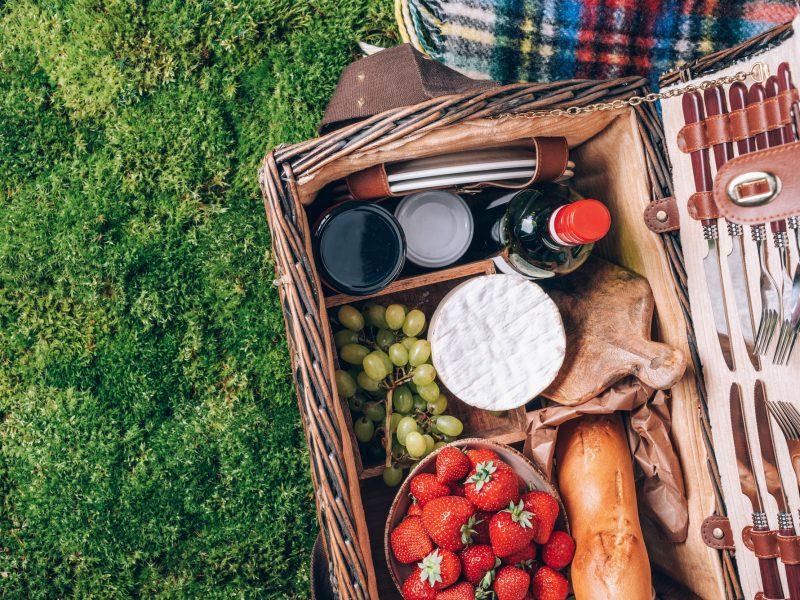 Great picnic basket with cheese, strawberries, grapes, baguette, wine for picnic