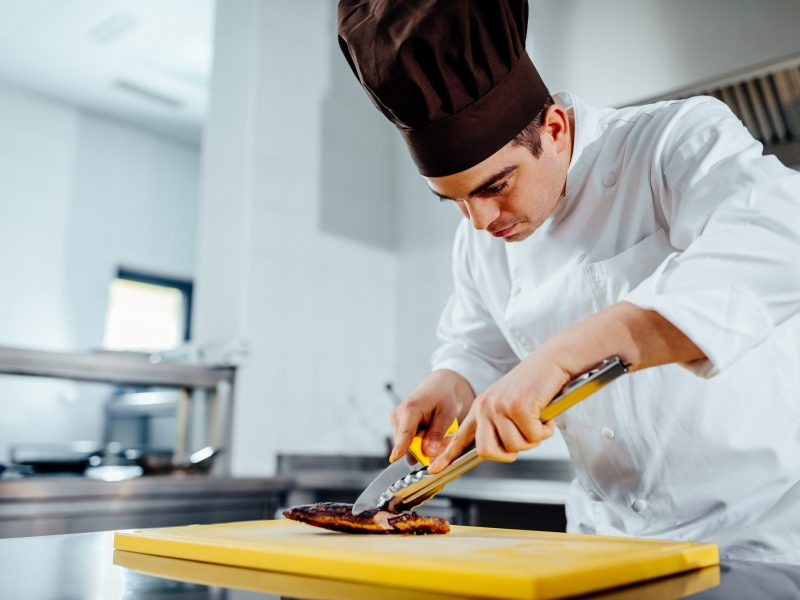 Preparing the restaurant's specialty